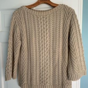 Neutral cable knit sweater.